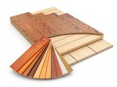 stock photo of laminate  - Installing laminate floor and wood samples - JPG