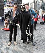 EDINBURGH- AUGUST 10: Members of Minotaur Theatre Company publicize their show The Librarians during Edinburgh Fringe Festival on August 10, 2013 in Edinburgh, Scotland