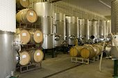 stock photo of fermentation  - Fermentation tanks and barrels of wine in cellar - JPG