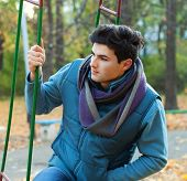 Young handsome man portrait, autumn outdoor.