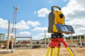 stock photo of theodolite  - Surveyor equipment theodolite outdoors at construction site - JPG