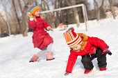 foto of snowball-fight  - Children in Winter Park playing with snowballs - JPG