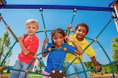 stock photo of playground  - Friends climbing the net at the playground - JPG