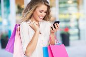 pic of sms  - Shopping woman text messaging - JPG