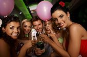 Bachelorette party in limousine with attractive young people, having fun.