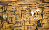 stock photo of leather tool  - Various old tools on the wall in leather craft workshop - JPG