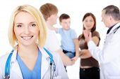 stock photo of medical doctors  - portrait of happy successful female doctor with the young family - JPG