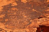 foto of rock carving  - Petroglyphs carved in orange rocks by Navaro at Valley of fire in Nevada state of United State - JPG