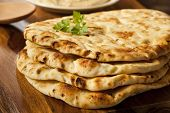 stock photo of flat-bread  - Homemade Indian Naan Flatbread made with Whole Wheat - JPG
