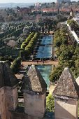 CORDOBA, SPAIN - JANUARY 4: View to the garden with pools from the tower of Alcazar in Cordoba, Spain on January 4, 2013. Since 1994, Alcazar included in UNESCO World Heritage list