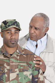 picture of united states marine corps  - Portrait of an African American US Marine Corps soldier with father over gray background - JPG