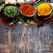 picture of condiment  - Spices and herbs over Wood - JPG