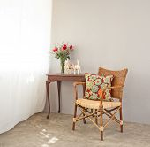 stock photo of bast  - beige bast chair with luxurious side table - JPG