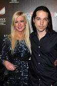 LOS ANGELES - FEB 11:  Tara Reid, Erez Eisen at the