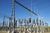 stock photo of transformer  - Electrical substation with blue and clear sky - JPG