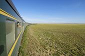 image of trans  - Trans Mongolian Train across the mongolian steppe - JPG