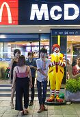 BANGKOK, THAILAND - JANUARY 9, 2012: Young local people stand in front of the McDonald's Restaurant