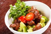 stock photo of liver fry  - chicken liver with vegetables - JPG