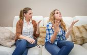 Furious mother arguing with her ??teenage daughter