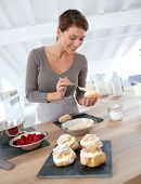 foto of cream puff  - Woman in kitchen preparing cream puffs - JPG