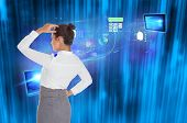 Businesswoman scratching her head against futuristic blue black background