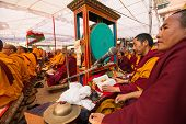 KHATMANDU, NEPAL - DEC 17: Unidentified tibetan Buddhist monks near stupa Boudhanath during festive