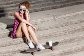 Beautiful Lady In Jeans Shorts With Skateboard At Stone Stairs