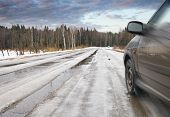 image of slippery-roads  - Car driving on slippery road before turning - JPG