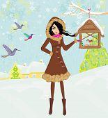 Girl Feeds The Birds In Winter