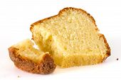 stock photo of pound cake  - sponge madeira or pound cake on white - JPG