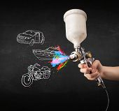 stock photo of air paint gun  - Man with airbrush spray paint with car - JPG