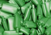 pic of pearlescent  - Heap of green nacreous plastic bottles for cosmetics - JPG