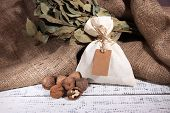 stock photo of sackcloth  - Sack full with spices - JPG