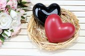 Decorative hearts in nest, on color wooden background