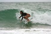 Female Surfer Catches Wave Off Florida Coast
