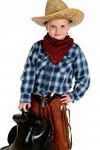Adorable Young Cowboy Hands On Hip Holding Saddle