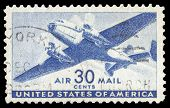 USA-CIRCA 1941: A 30 cent United States Airmail postage stamp shows image of a twin-engined transpor