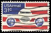 USA-CIRCA 1976: A 21 cent United States Airmail postage stamp, shows image of Plane and Globes on re