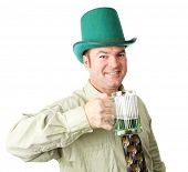 Handsome Irish American man celebrating St Patrick's Day with green beer.  Isolated on white.