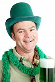 Irish American man gets drunk on green beer for St. Patricks Day.  White background.