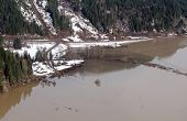 foto of snow-slide  - Mudslides scar the hillsides of Washington state following heavy rain on top of snow - JPG