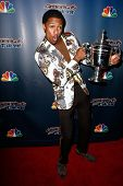 NEW YORK-AUG 6: TV host Nick Cannon holds the US Open Tennis trophy at the 'America's Got Talent' post show red carpet at Radio City Music Hall on August 6, 2014 in New York City.