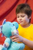 A Boy With A Soft Toy Dragon - A Symbol Of The New Year