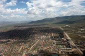 picture of ulaanbaatar  - The sweeping remote hills of Mongolia are marked only by primitive roads and clusters of simple cabins - JPG