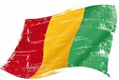 waving Guinean grunge flag. flag of  Guinea in the wind with a texture