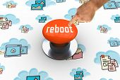 foto of reboot  - The word reboot and hand pointing against orange push button - JPG