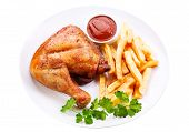 Plate Of Grilled Chicken Leg With Fries