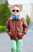 foto of bomber jacket  - cool young kid walking the city street - JPG