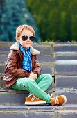 picture of bomber jacket  - cute stylish boy in leather jacket and gum shoes - JPG