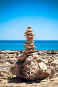 pic of fulcrum  - Stones balance pebbles stack over blue sea - JPG